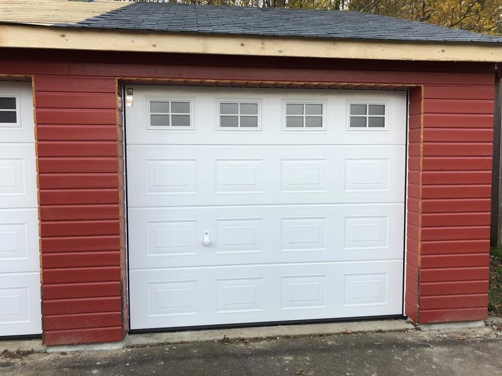 Pose d'une porte de garage sectionnelle verticale Hormann par menuisier Rge, secteur Yvetot / Yerville , 76 -Seine Maritime (76)