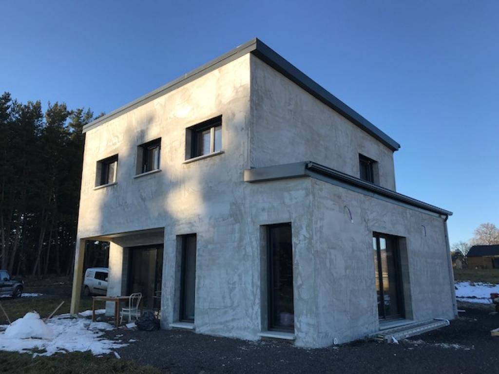 Pompe à chaleur hybride gaz dans une maison neuve Cantal