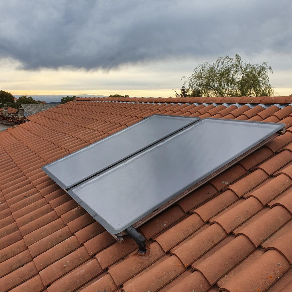 Installation chaudière à granulés Hargassner avec silo textile et Chauffe-eau solaire en remplacement chaudière fioul