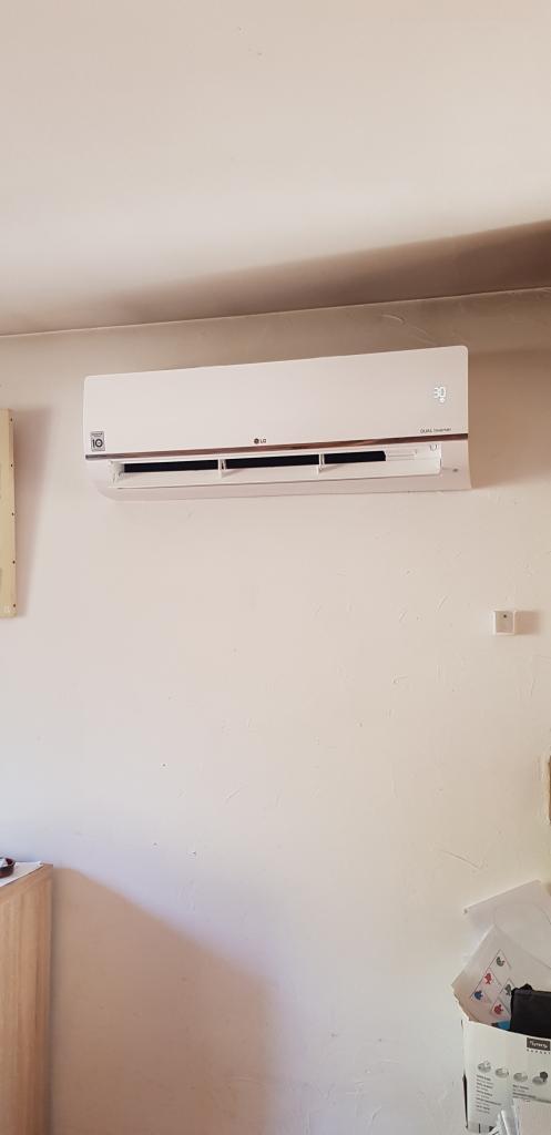 Installateur Climatisation : Installation d'un système de climatisation dans le salon