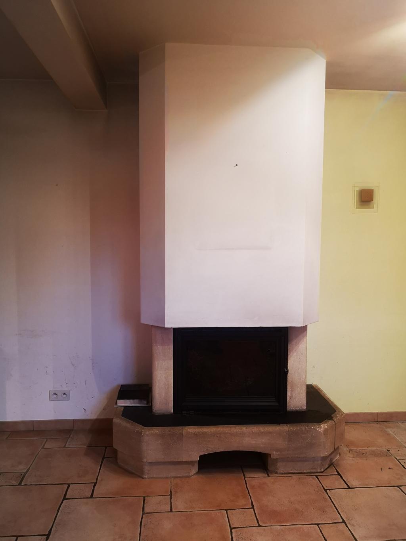 Installation d'un poêle de masse en remplacement d'une cheminée