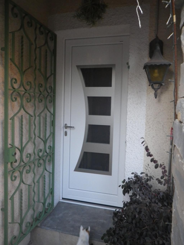 Notre réalisation : Pose de porte d'entrée  aluminium en Rénovation
