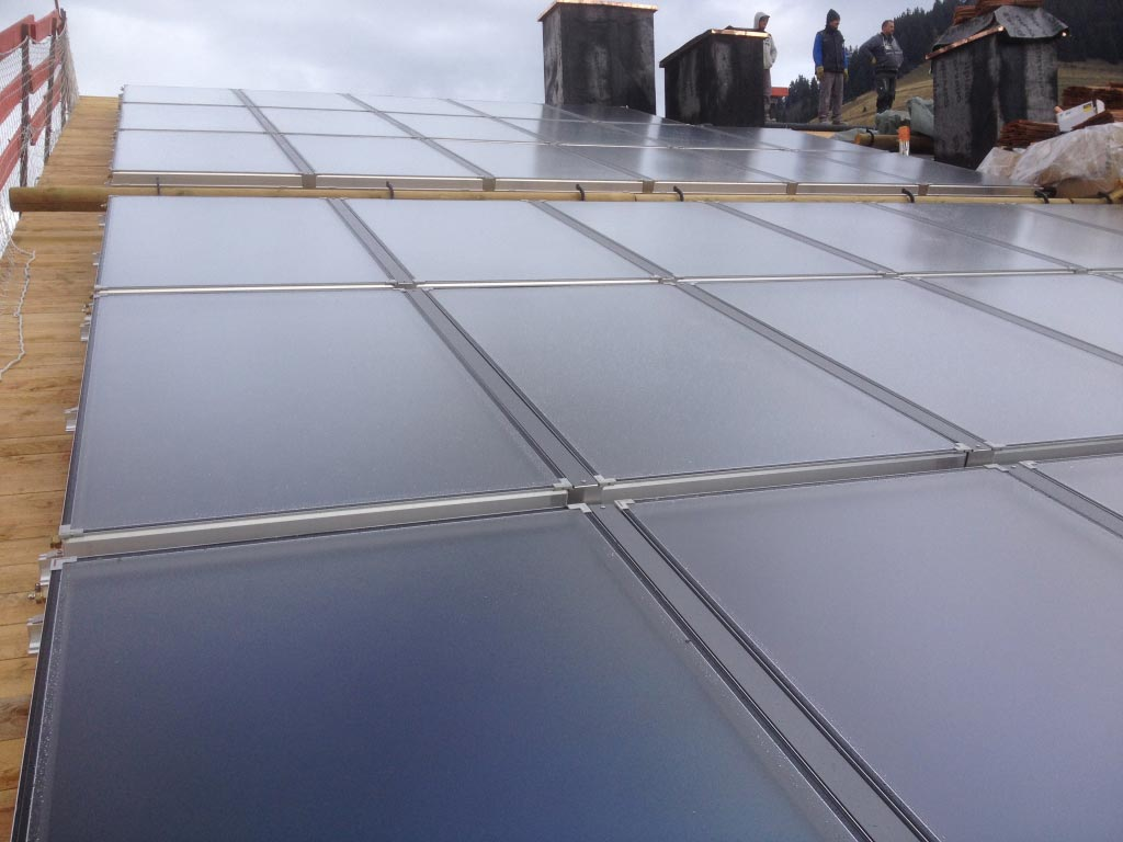 Installateur Piwienergies quali sol RGE - Champ solaire thermique Weishaupt à Megève 74 Haute Savoie