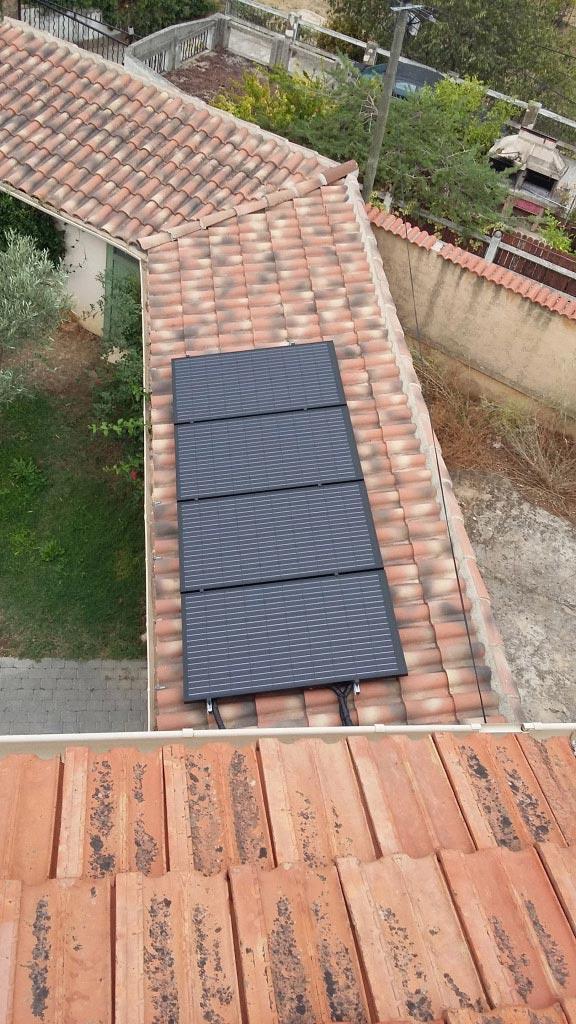 Installation d'une chaudière à granulés (pellets) OKOFEN, d'un chauffe eau solaire SONNENKRAFT avec panneaux solaires hybrides DUALSUN